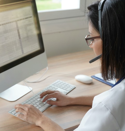 woman writing in computer